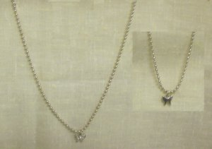 Silver necklace and bracelet set w/ small silver butterfly