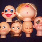 3 inch assorted dolls faces, soft plastic