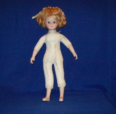 Porcelain Decorative doll with beige and flower dress