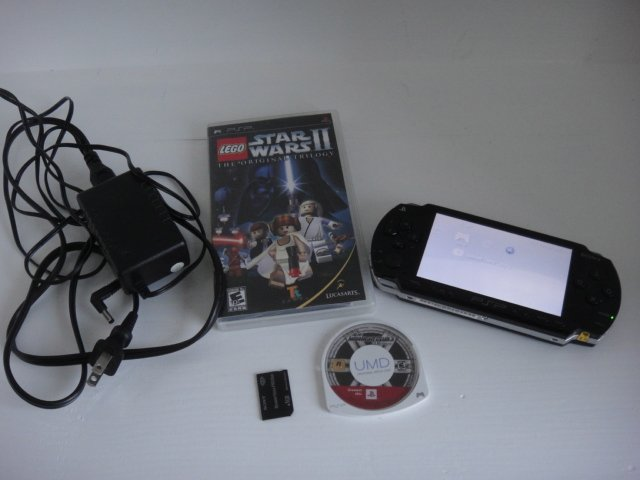 Sony Playstation PSP 1001 with 2 games and 1GB memory stick FW 5.51