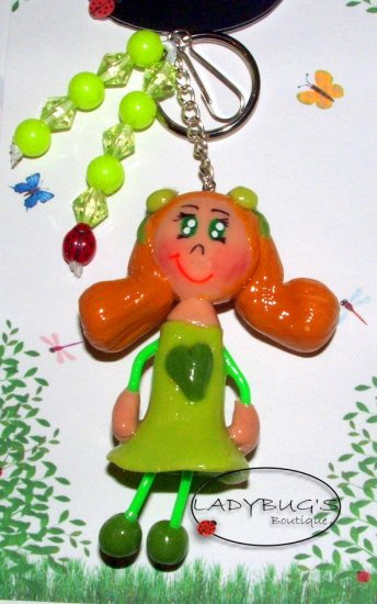 Unique Handcrafted zipper pull - Blonde Girl with pig tails, green dress
