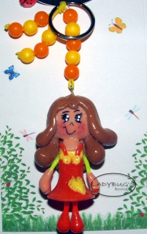 Unique Handcrafted zipper pull - Girl with orange and yellow dress