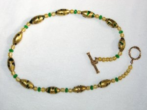 Green and gold glass beads