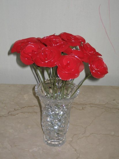 dozen roses arranged in a crystal vase