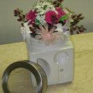flowers arranged in a sugar jar