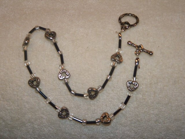 Black beads with silver toned hearts anklet