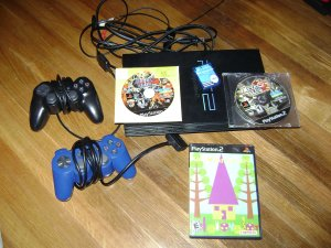 Sony Playstation 2 with 2 controllers and 3 games