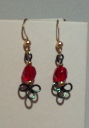 green shamrock with read beads
