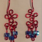 red loops with beads