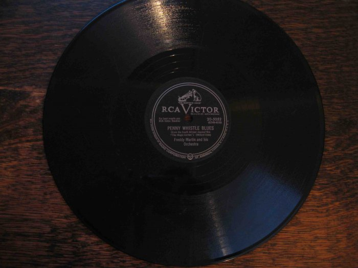 "Freddy Martin 78 rpm record, ""Penny Whistle Blues"" b/w ""April in Portugal"""