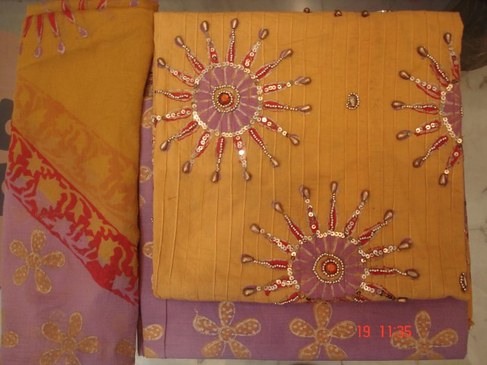 T-206: Lavender Colored Salwar & Kameez with heavy Sequence Work