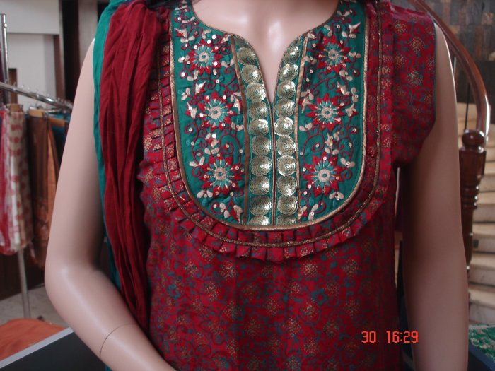 T-489: Maroon with green and golden print ready made suit