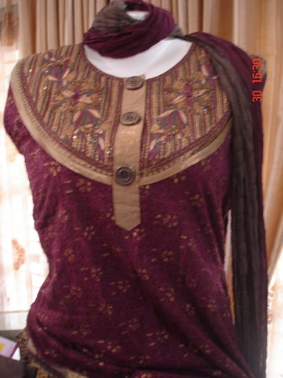 T-491: Pink textured Ready made Suit with golden paint and embroidery at neck
