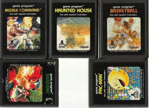 5 Atari 2600 game cartridges - Pac-Man, Berzerk, +++