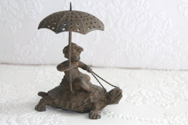 Antique Pairpoint Cherub Holding Umbrella Riding Turtle or Tortoise Toothpick Holder