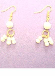 Whiite cats eye glass triple dangle earrings $6.15