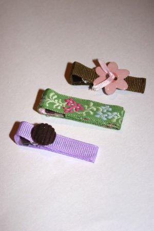 Set of three bright spring alligator clips