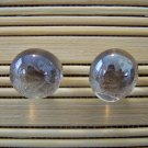 glass with taupe stud earrings