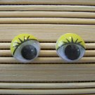 yellow eyelid wigglie eye stud earrings