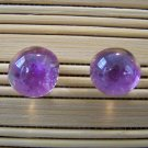 glass with purple stud earrings