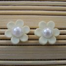 white flower with pearl stud earrings