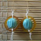 yellow stone ring with blue bead dangle earrings