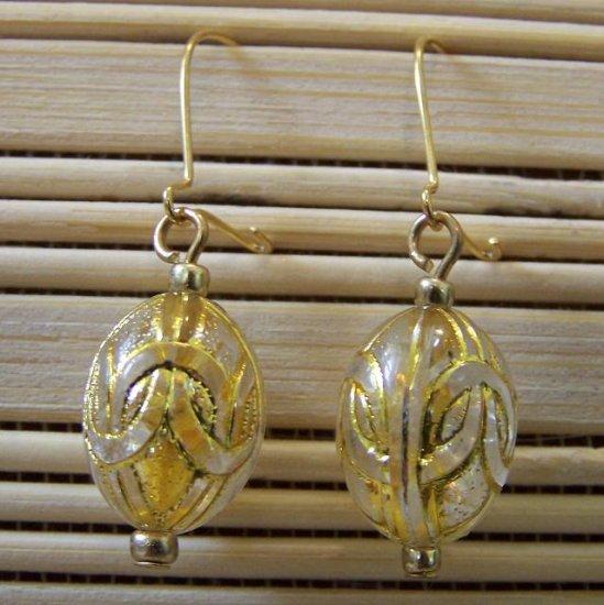 gold egg dangle earrings