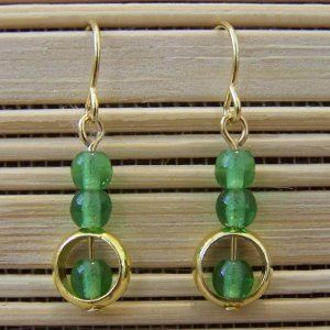 gold ring and emerald green glass dangle earrings