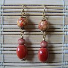 rusty red wooden sectioned with gold dangle earrings