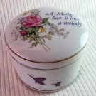 Vintage Porcelain A Mother's Love is Like a Melody Round Music Box Plays Shadow of Your Smile 3-in