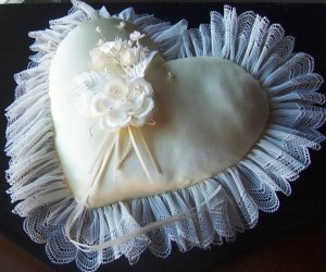 Ivory Heart Pillow with sheer pleated lace border