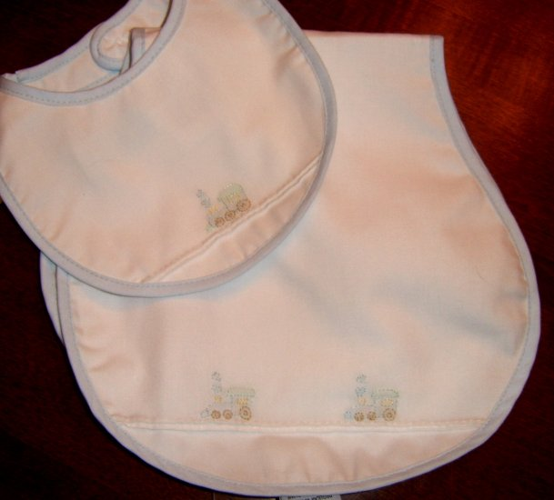 Newborn Cotton Baby Bib with embroidered airplanes.