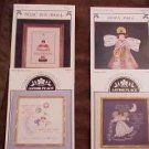 A 4-Pak Assortment of Cross Stitch Patterns ~a