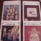 A 4-Pak Assortment of Cross Stitch Patterns ~i