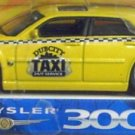 "Jada Toys Dub City Kustoms Chrysler 300C ""Dub City Taxi"" 1/64 Scale Diecast Collectible"