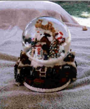 Santa's flight snowglobe