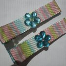 Multi colored Stripes Ribbon with Blue Flower shaped Rhinestone Clippies