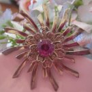 Silver toned, starburst broach with Amythest stone in middle (Vintage)