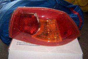 Mitsubishi lancer left Tail light