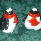 VINTAGE FAT PENGUINS SALT PEPPER SHAKERS WITH RED SCARVES AND GOLD FEET. GOOD CONDITION. O!