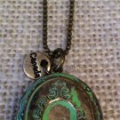 Green, metal necklace with locket $24.99 #138N511G