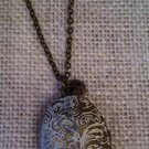 White, etched filigree locket with necklace $24.99 #138N501W