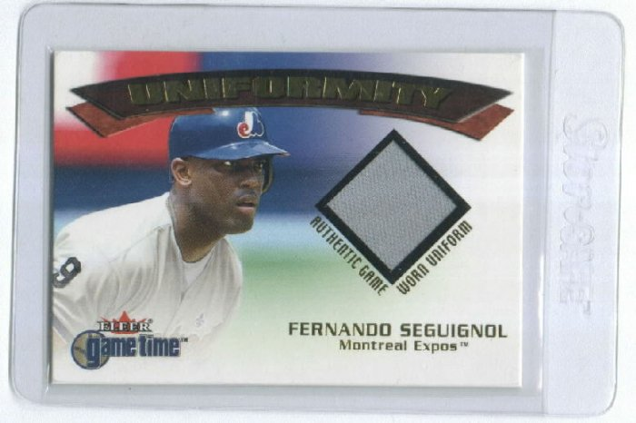 2001 FLEER GAME TIME UNIFORMITY FERNANDO SEGUIGNOL EXPOS GAME WORN UNIFORM CARD