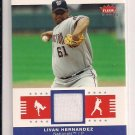 2006 FLEER TRADITIONAL THREADS LIVAN HERNANDEZ NATIONALS JERSEY CARD
