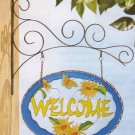 "Flowery ""welcome"" sign"