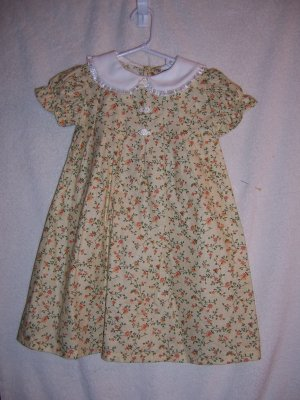 Yellow and white dolly  dress with hat size 2