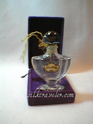 Shalimar Guerlain perfume bottle, velvet case,  Paris France.   crystal?