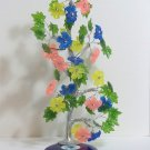 Large Tree with flowers standing on eye charm