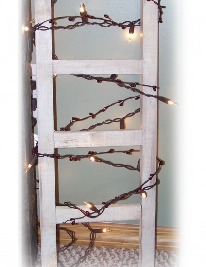 Prim Ladder w/ lights & berries