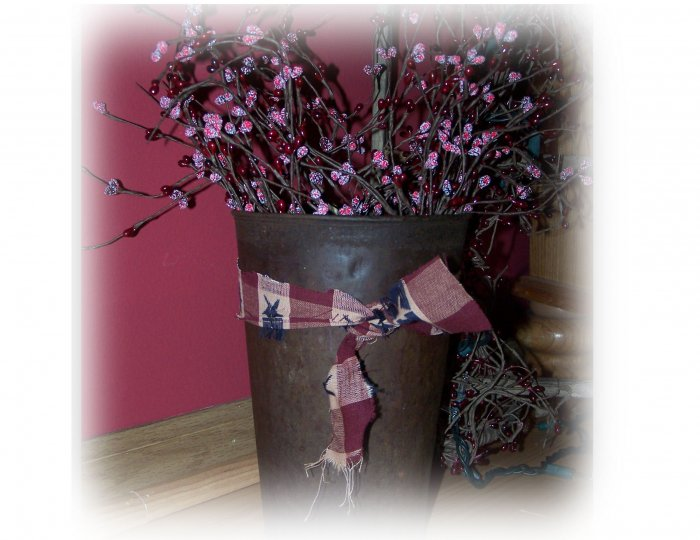 Antique maple syrup bucket with berries